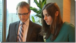 Lawyer Geoffrey Trotter reviews Bethany Paquette's human rights complaint with her. (Photo from CBC)