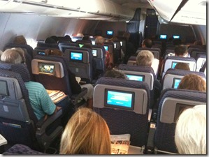 Picture of airplane cabin with seat-back screens found via Google
