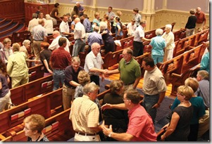 Mutual greetings at Parker Memorial Baptist Church, Anniston AL. Photo from The Anniston Star, found via Google
